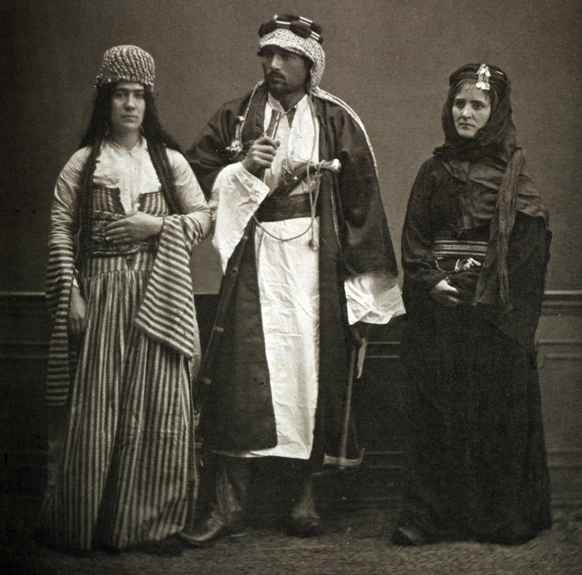 A Jewish woman and a couple of Bedouins in Aleppo, 1873.jpg
