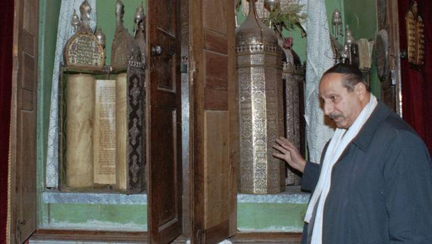 Youssef Jajati, a Jewish community leader, shows the Torah holy book in Jobar Synagogue which dates back to 718 BC.jpg